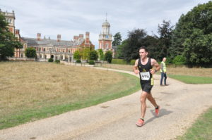 Runners in the Great Yarmouth Half Marathon running past Somerleyton Hall