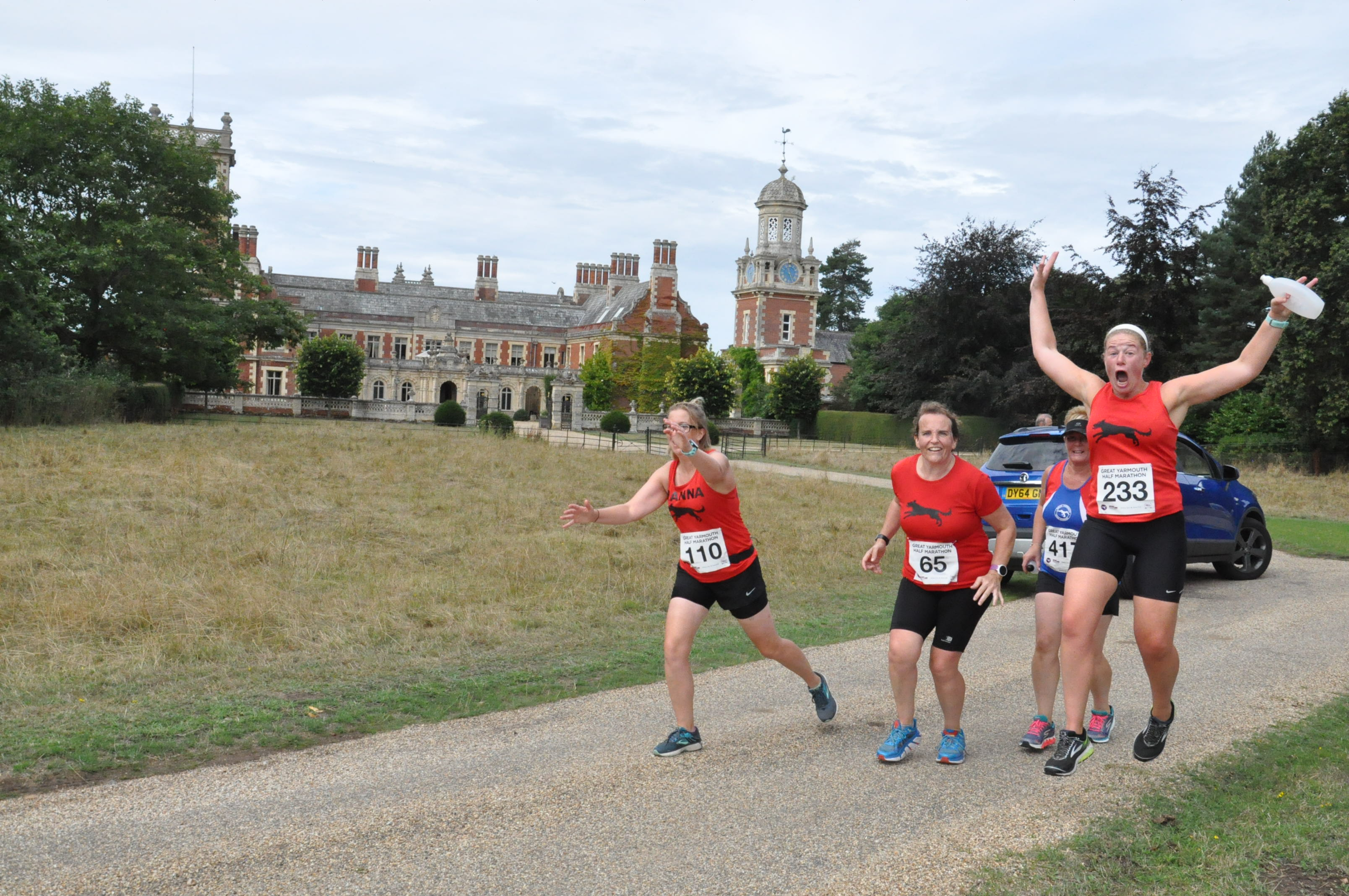 Runners in great yarmouth half marathon running past Somerleyton Hall